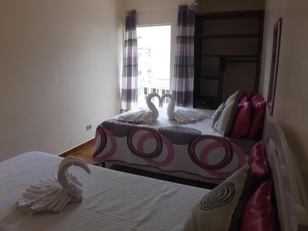 A bed or beds in a room at Apartamento Condomínio Paola