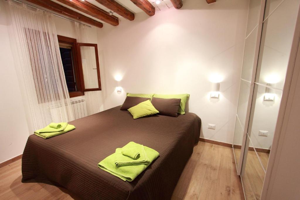 Un ou plusieurs lits dans un hébergement de l'établissement Ca Sacrestia