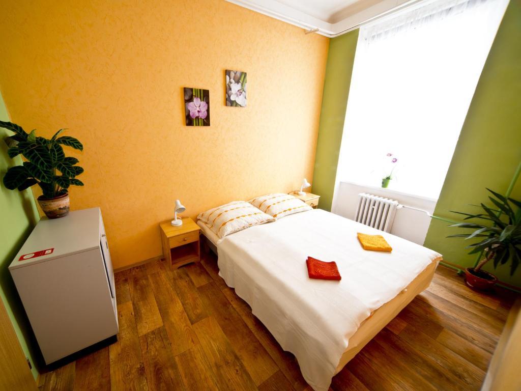 Postel nebo postele na pokoji v ubytování Hostel SKLEP