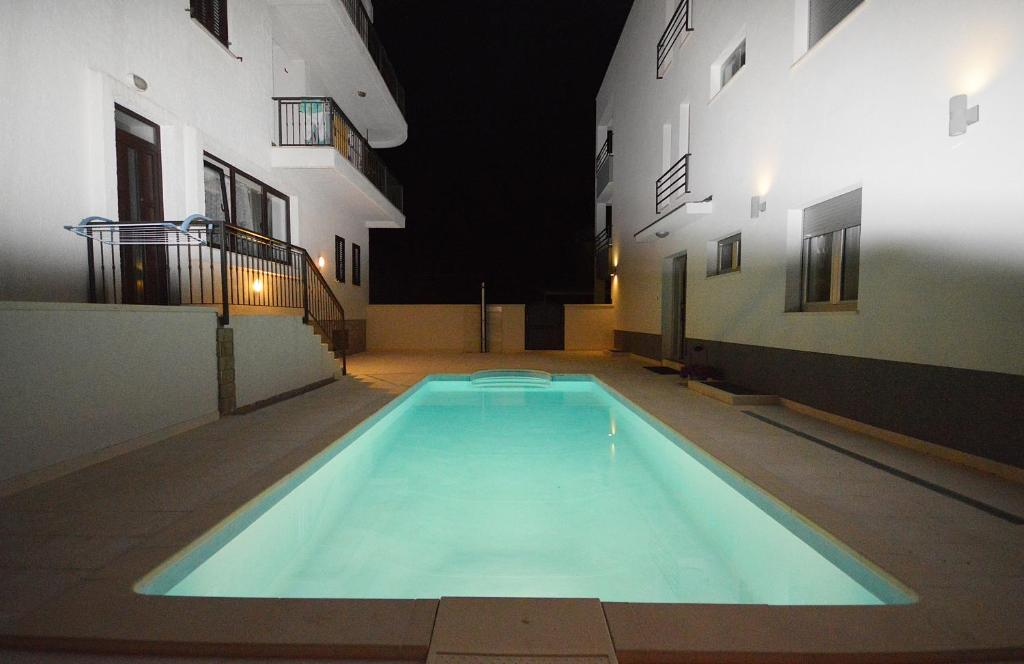 The swimming pool at or near Apartments Villa Kovac