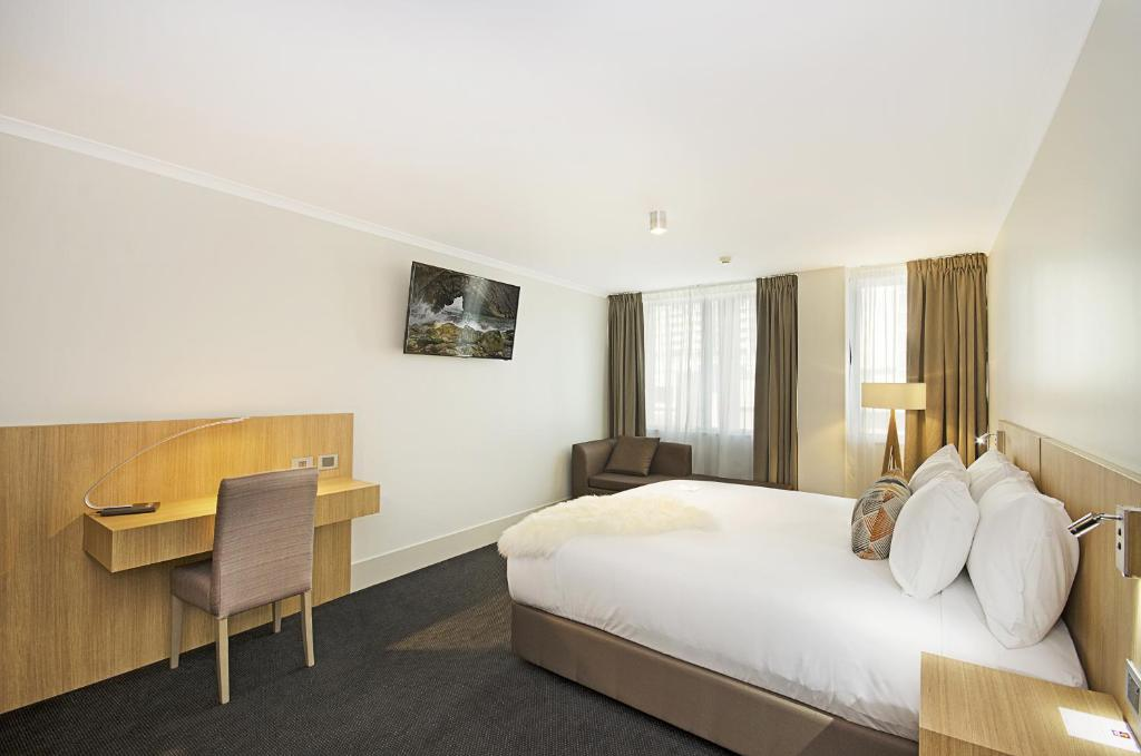 A bed or beds in a room at Clarion Hotel Townsville
