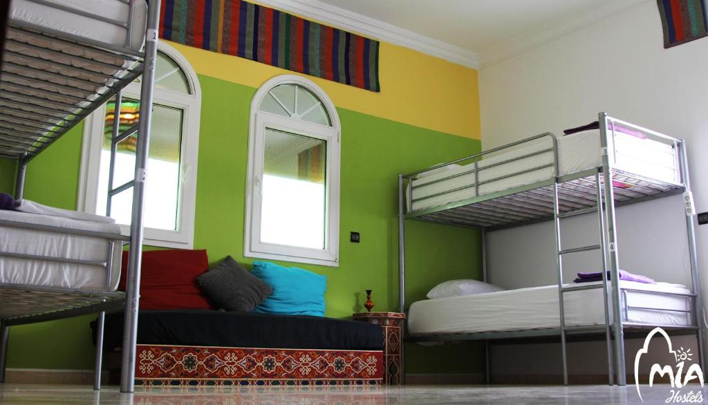 A bunk bed or bunk beds in a room at MIA Hostels Assilah