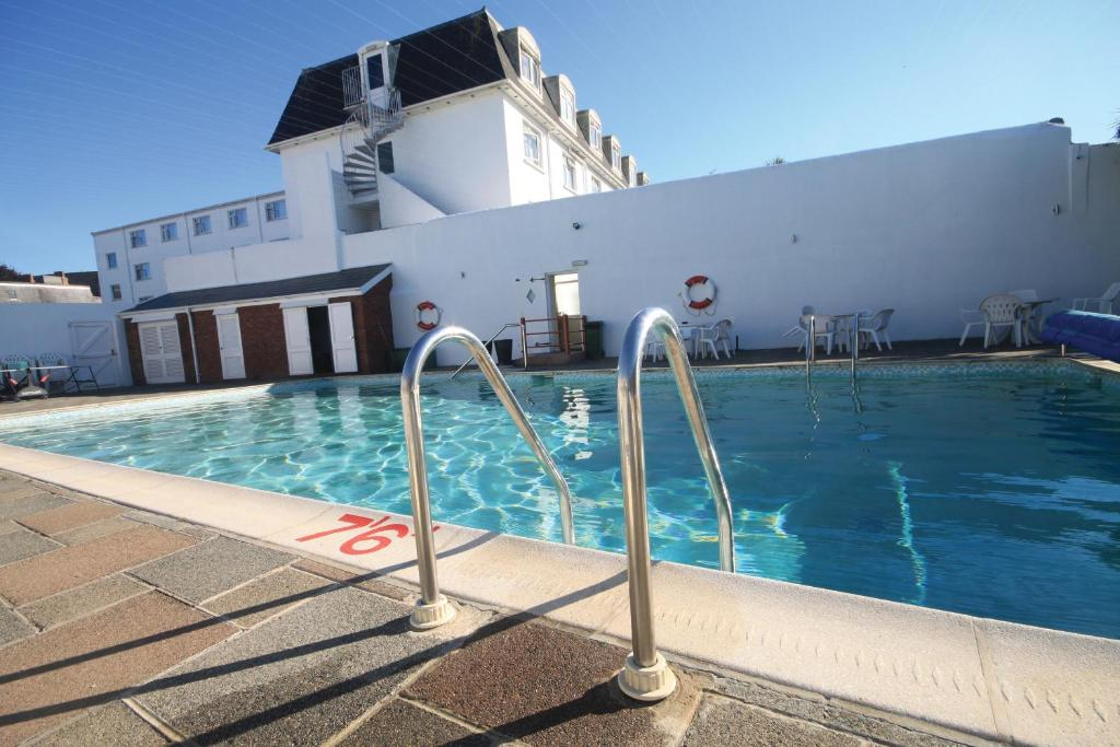 The swimming pool at or near Norfolk Hotel