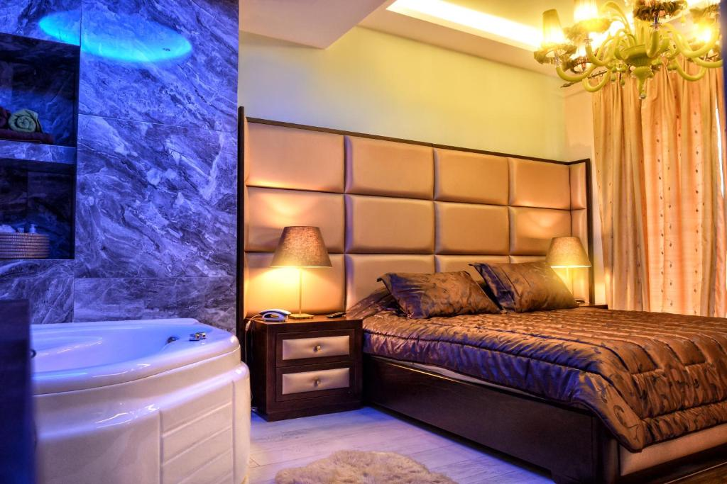 A bed or beds in a room at Orfeas Classic