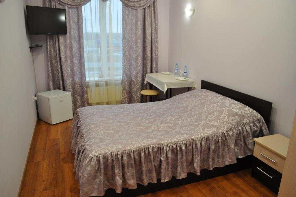 Кровать или кровати в номере Гостиница Артик