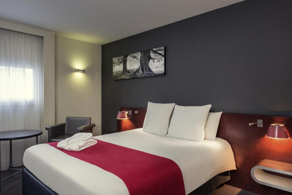Un ou plusieurs lits dans un hébergement de l'établissement Mercure Rennes Centre Gare