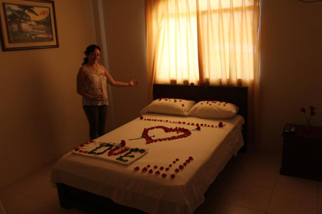 A bed or beds in a room at Hostal Rosa Mar