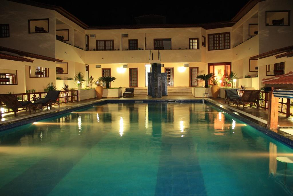 The swimming pool at or near Hotel e Pousada Canoa Quebrada