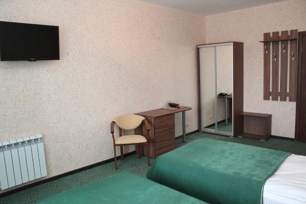 Телевизор и/или развлекательный центр в Отель Кубань