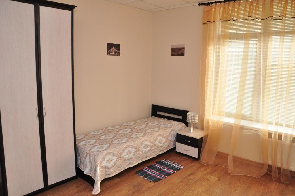 A bed or beds in a room at UA Hostel