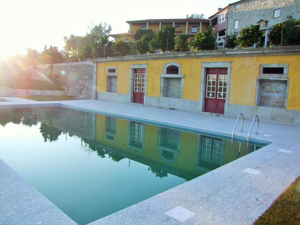 The swimming pool at or near Quinta do Rocha