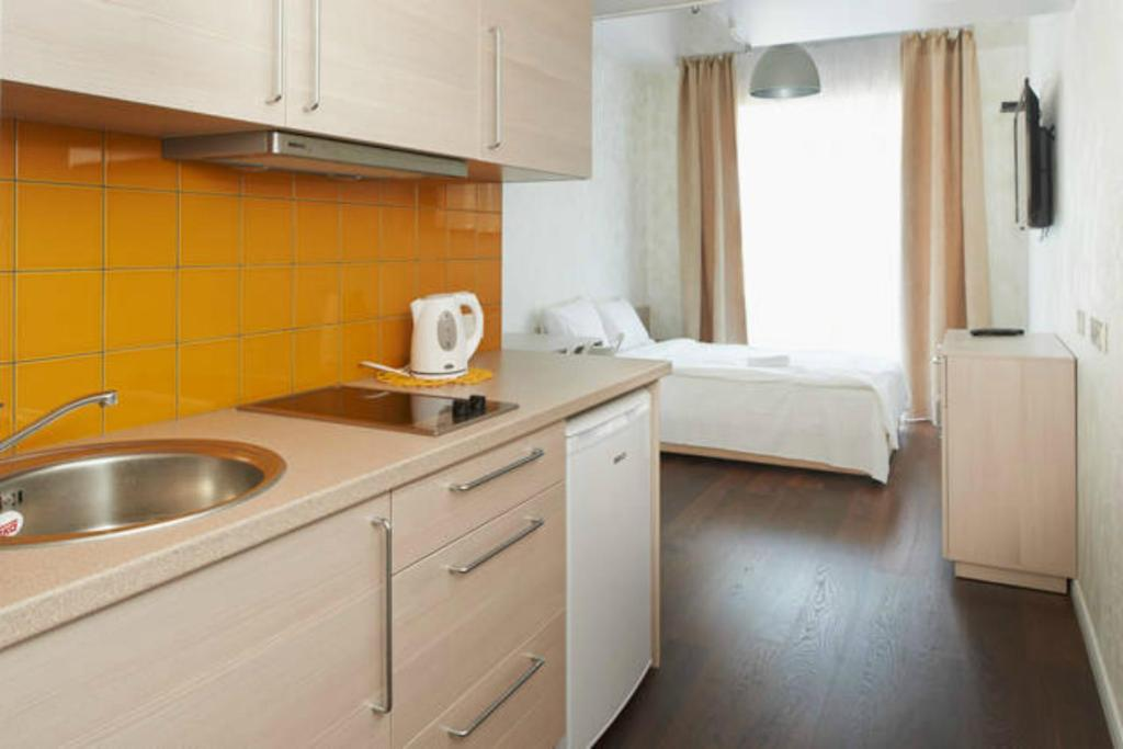 A kitchen or kitchenette at Natalex MicroLofts