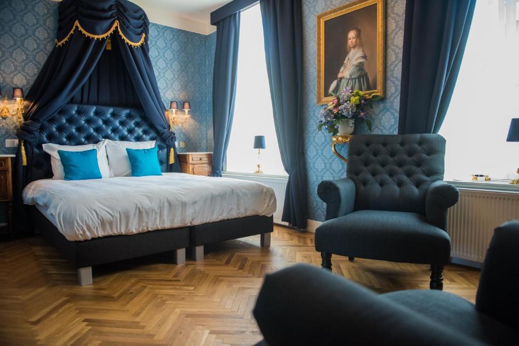 Ein Bett oder Betten in einem Zimmer der Unterkunft De Barones Van Leyden