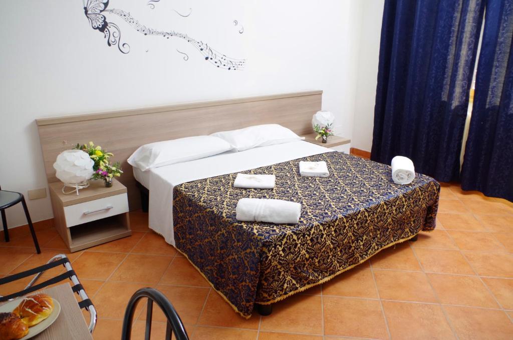 Кровать или кровати в номере Hotel Centrale