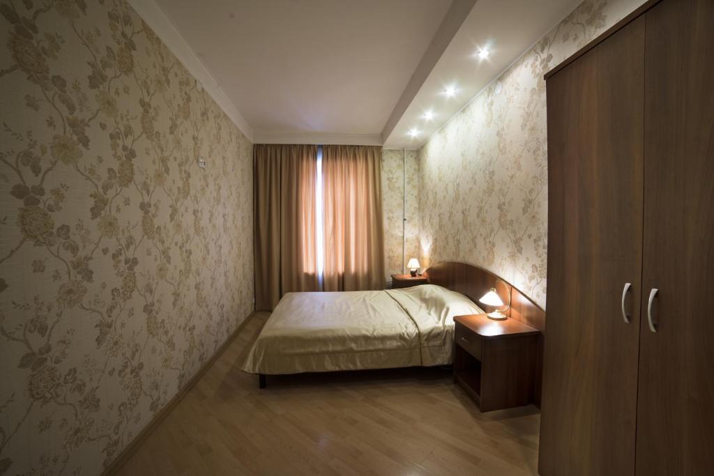 Кровать или кровати в номере Апартаменты Амулет