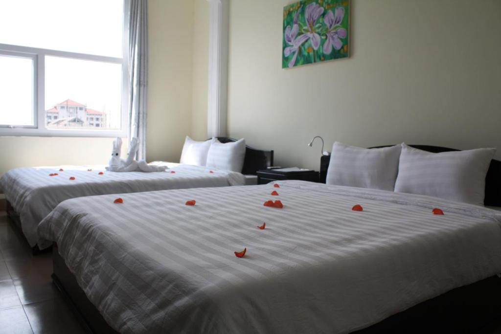 Ein Bett oder Betten in einem Zimmer der Unterkunft Jade Hotel