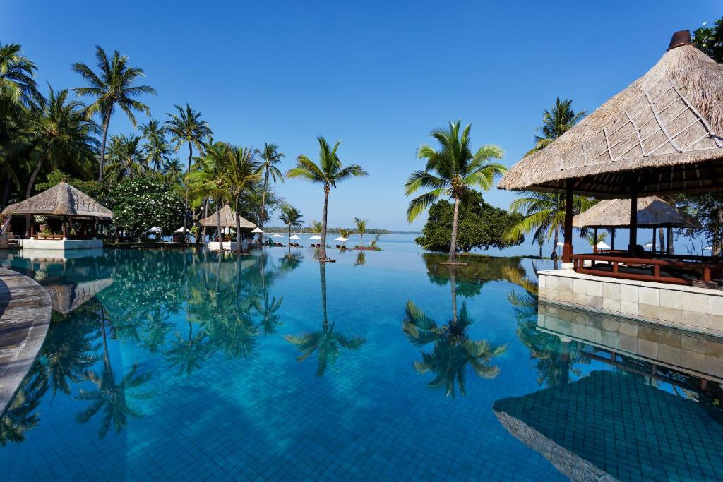 The swimming pool at or near The Oberoi Beach Resort, Lombok