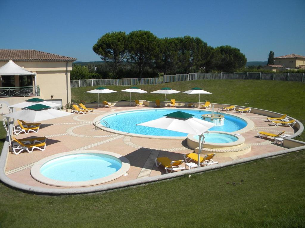 A view of the pool at Hôtel du Golf - Domaine de la Valdaine or nearby