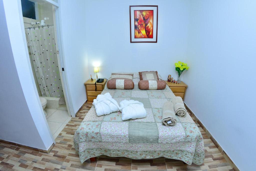 A bed or beds in a room at Matryoshka