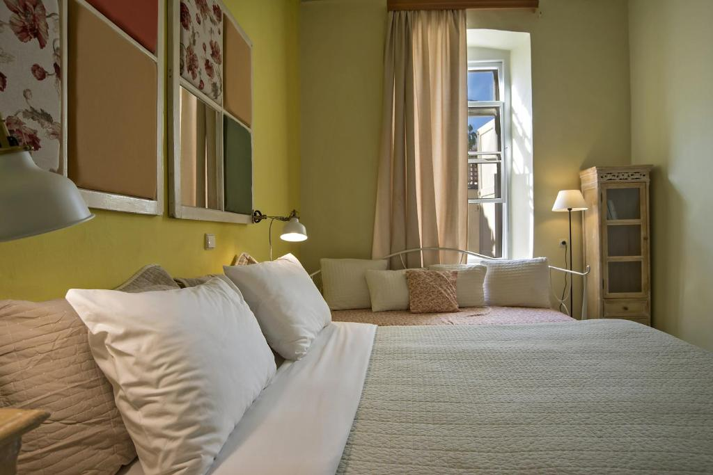 A bed or beds in a room at Anatolia Charming Hotel