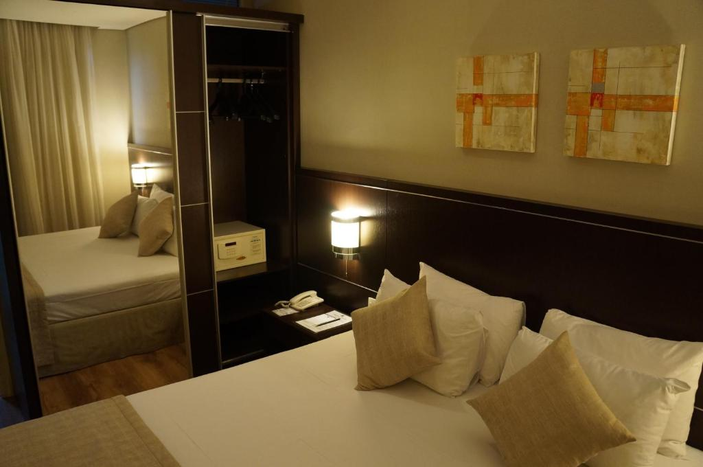 A bed or beds in a room at Travel Inn Osasco