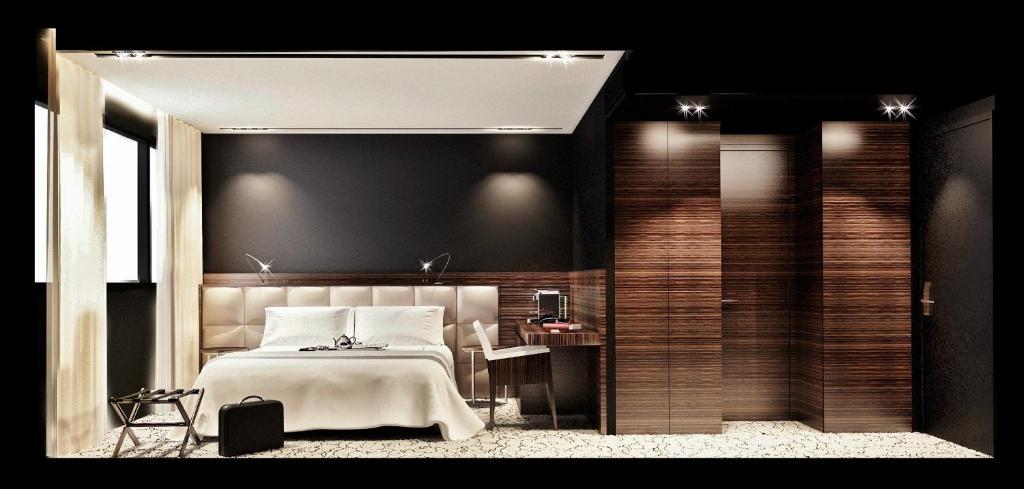 Un ou plusieurs lits dans un hébergement de l'établissement Howard Hotel Paris Orly Airport