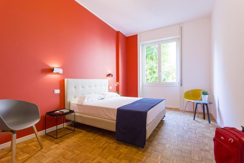 A bed or beds in a room at Dreams Hotel Residenza Corso Magenta
