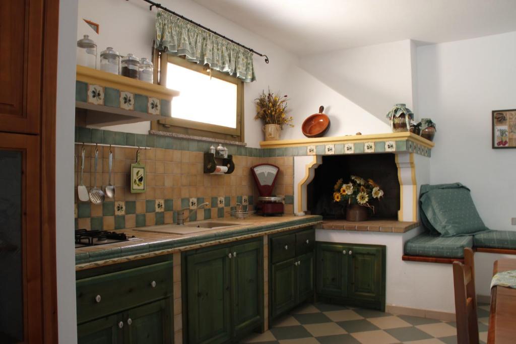 A kitchen or kitchenette at Casa Pein