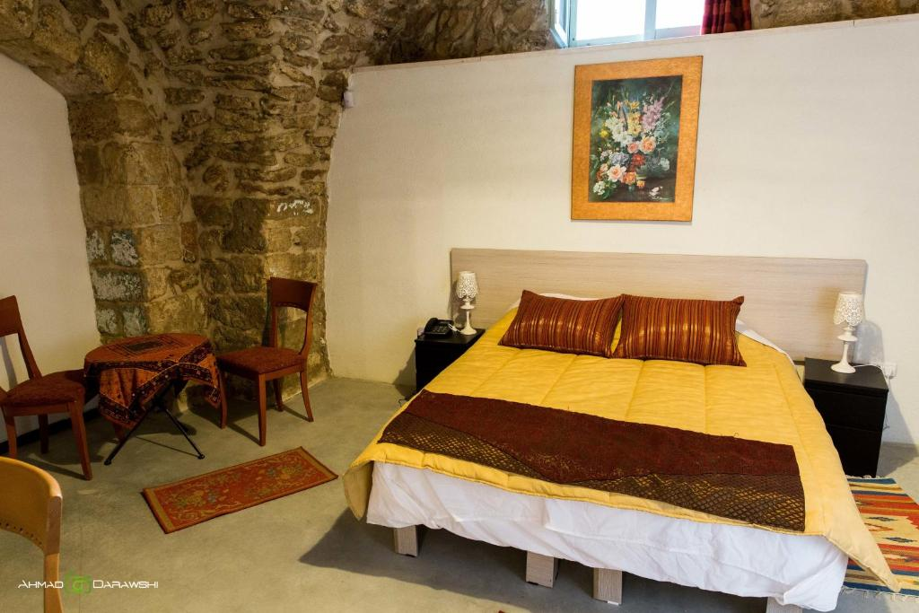 Кровать или кровати в номере Al-Hakim Guest House