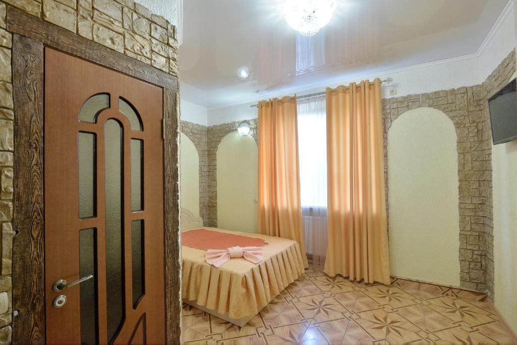 Кровать или кровати в номере Отель №1