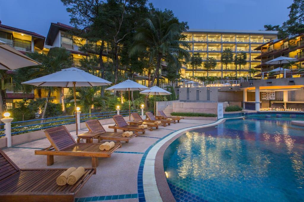 The swimming pool at or near Chanalai Flora Resort, Kata Beach