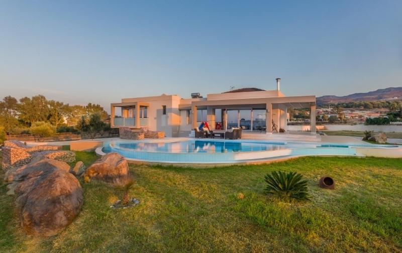 The swimming pool at or near Villa Fotaki