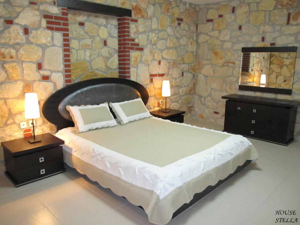 A bed or beds in a room at Psakoudia Villas