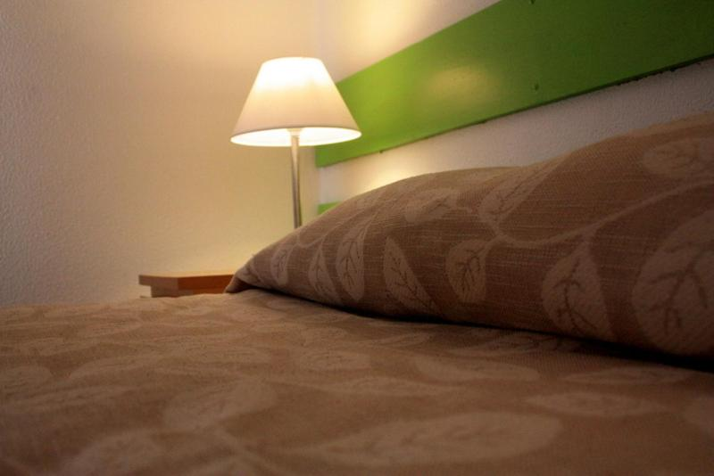 A bed or beds in a room at E-Nove Lounge Hostel Caffe