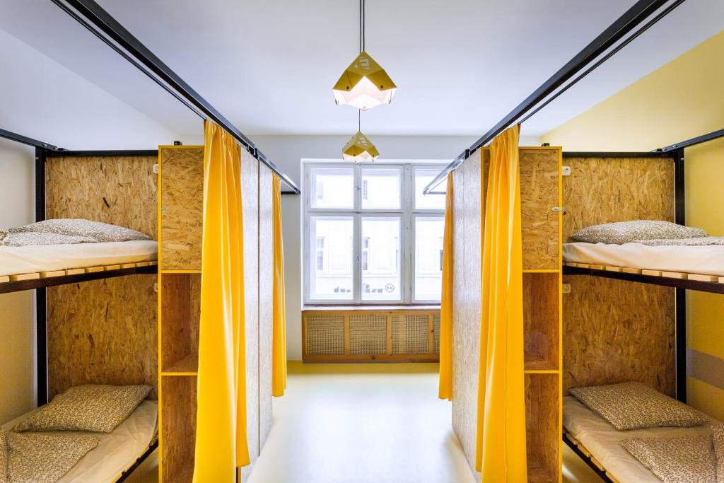 A bunk bed or bunk beds in a room at Essential Hostel