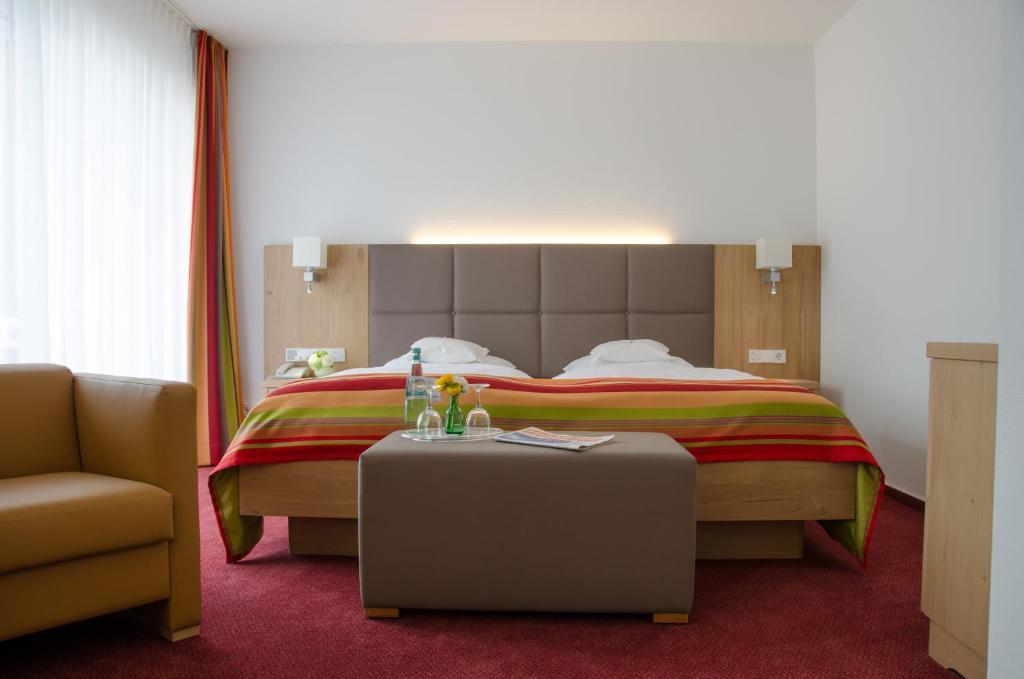 Gulta vai gultas numurā naktsmītnē Hotel Wieting Superior