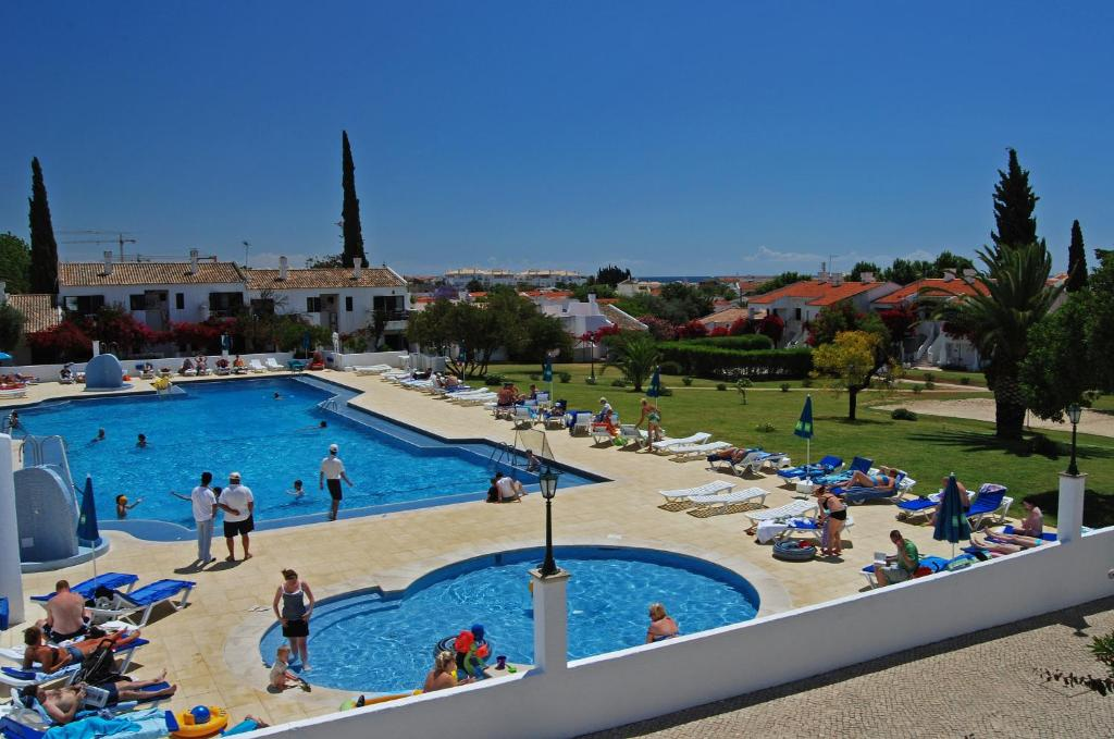 A view of the pool at Pedras Da Rainha or nearby