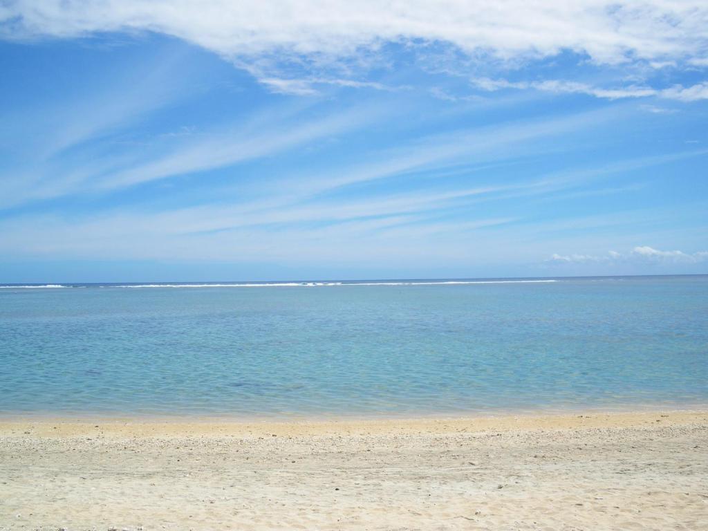 Ein Strand an oder in der Nähe der Villa