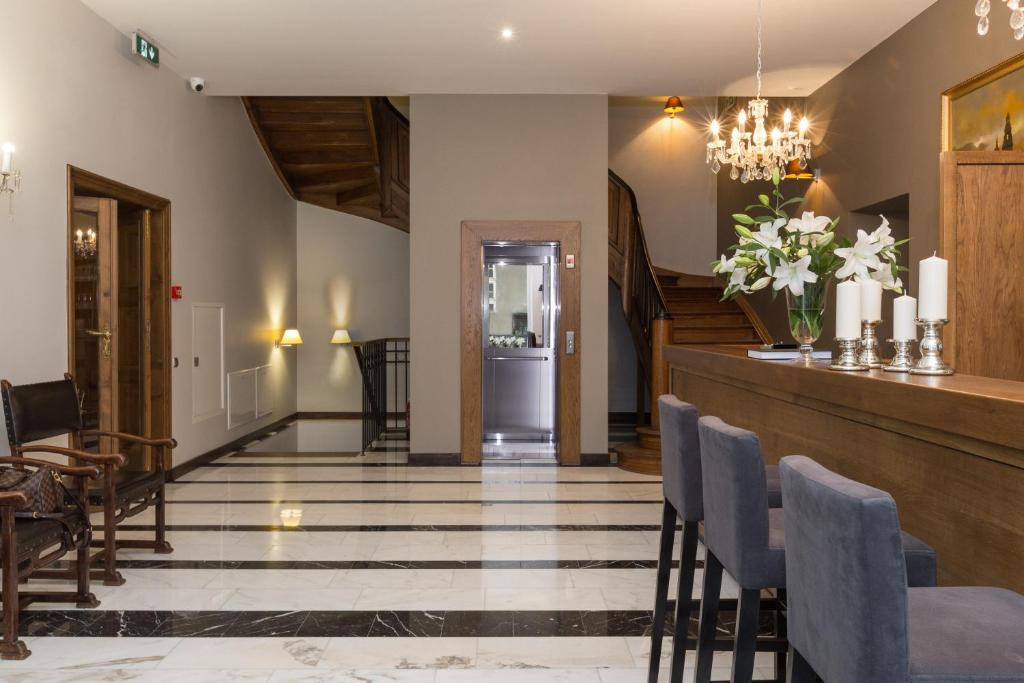 The lobby or reception area at Grottger Boutique Hotel