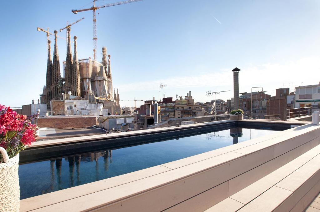 The swimming pool at or near Enjoybcn Gaudi Apartments