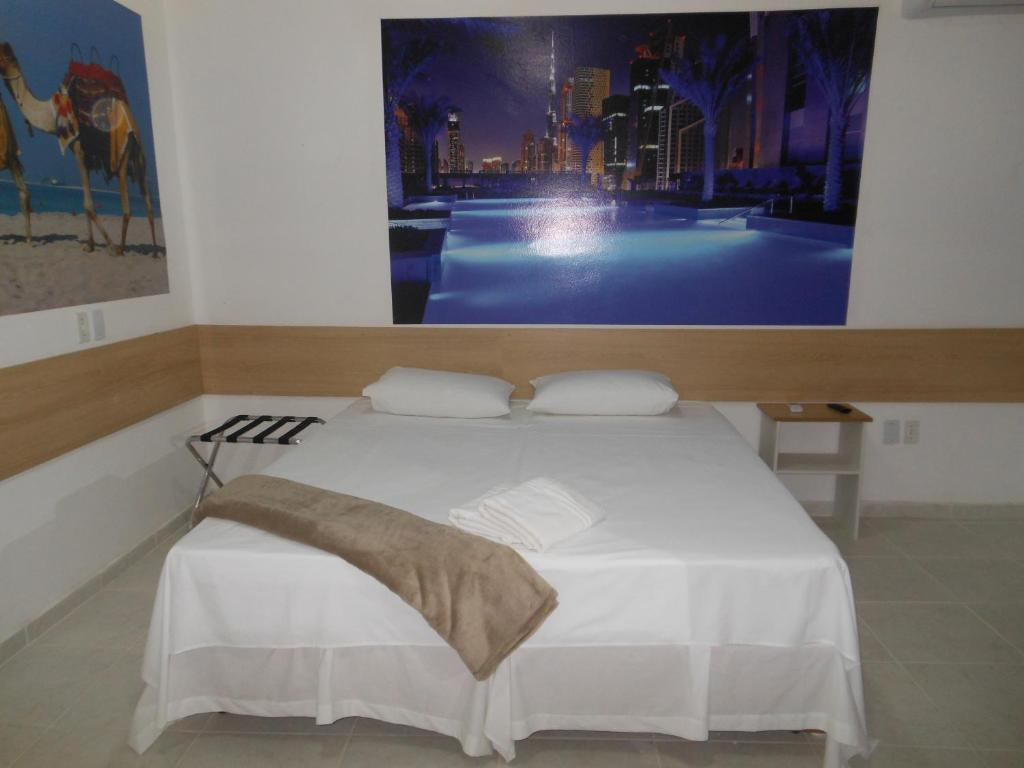A bed or beds in a room at Pousada Dubai