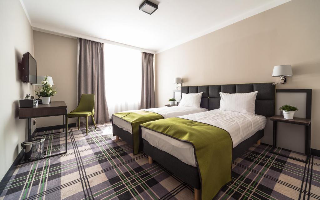 Ein Bett oder Betten in einem Zimmer der Unterkunft Hotel Impresja