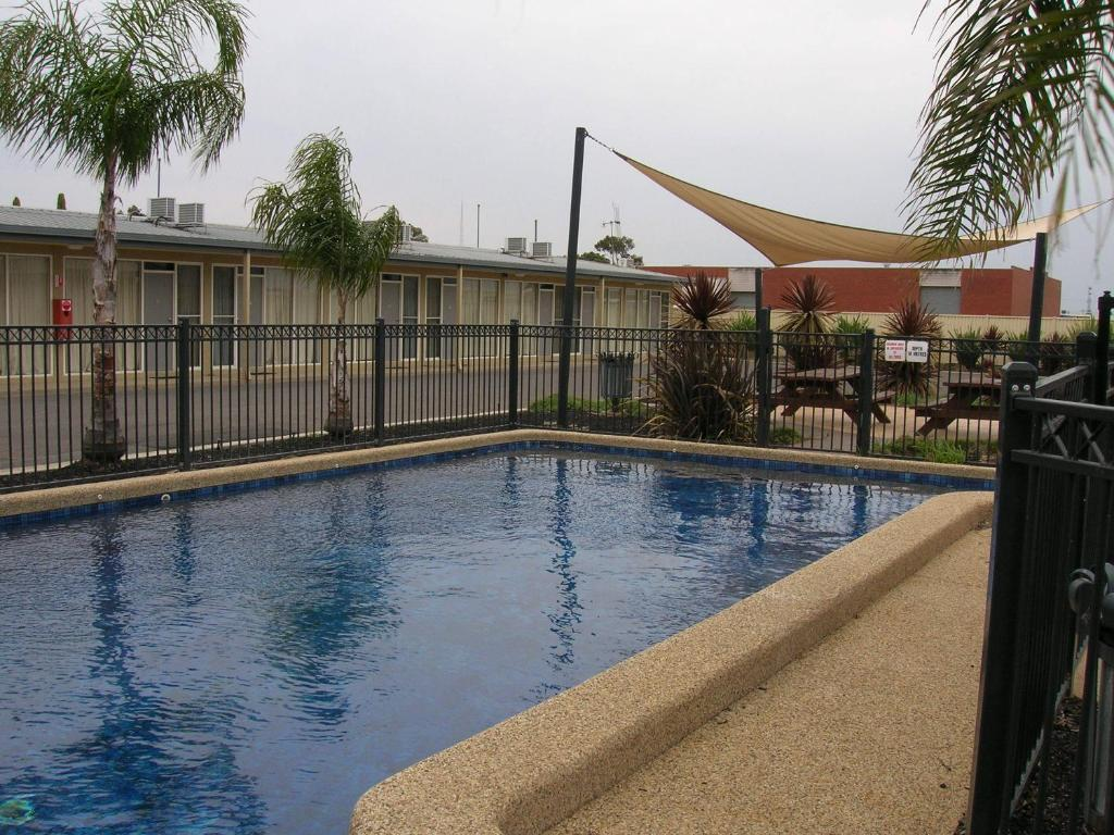 The swimming pool at or near Overlander Hotel Motel