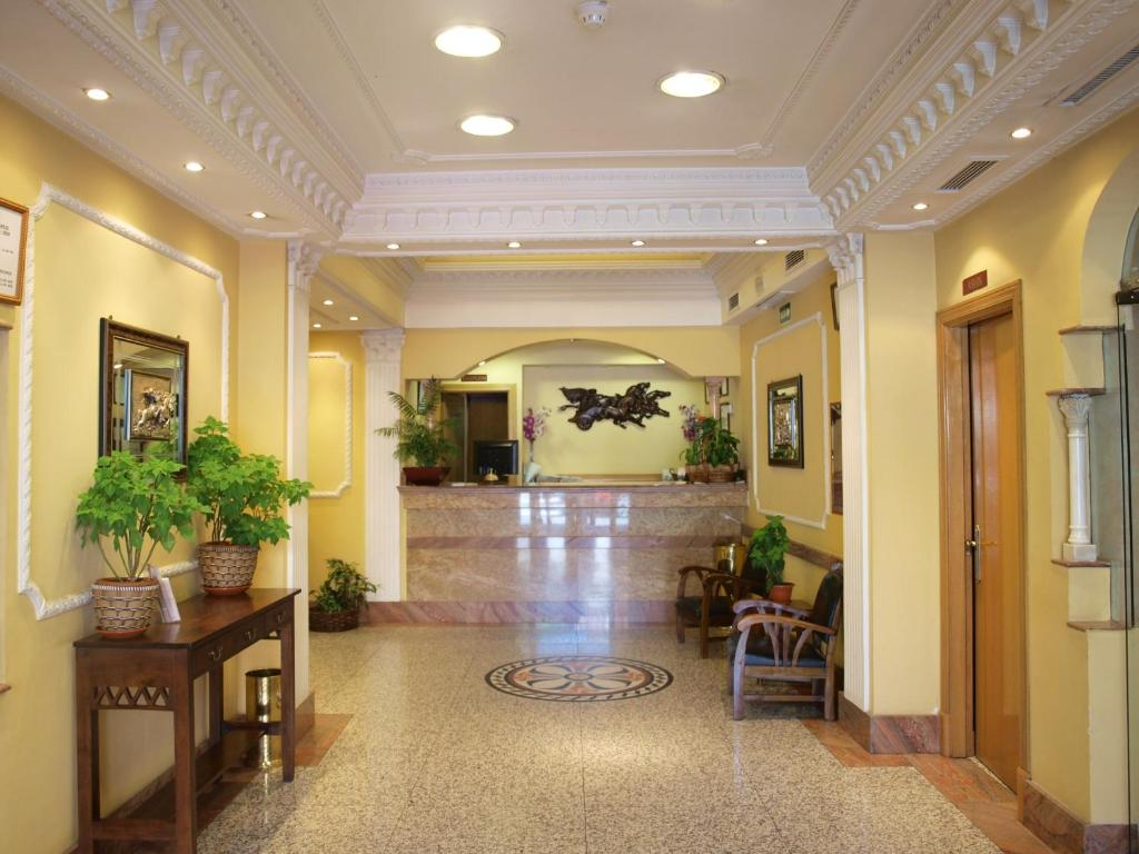 The lobby or reception area at Hotel Don Luis