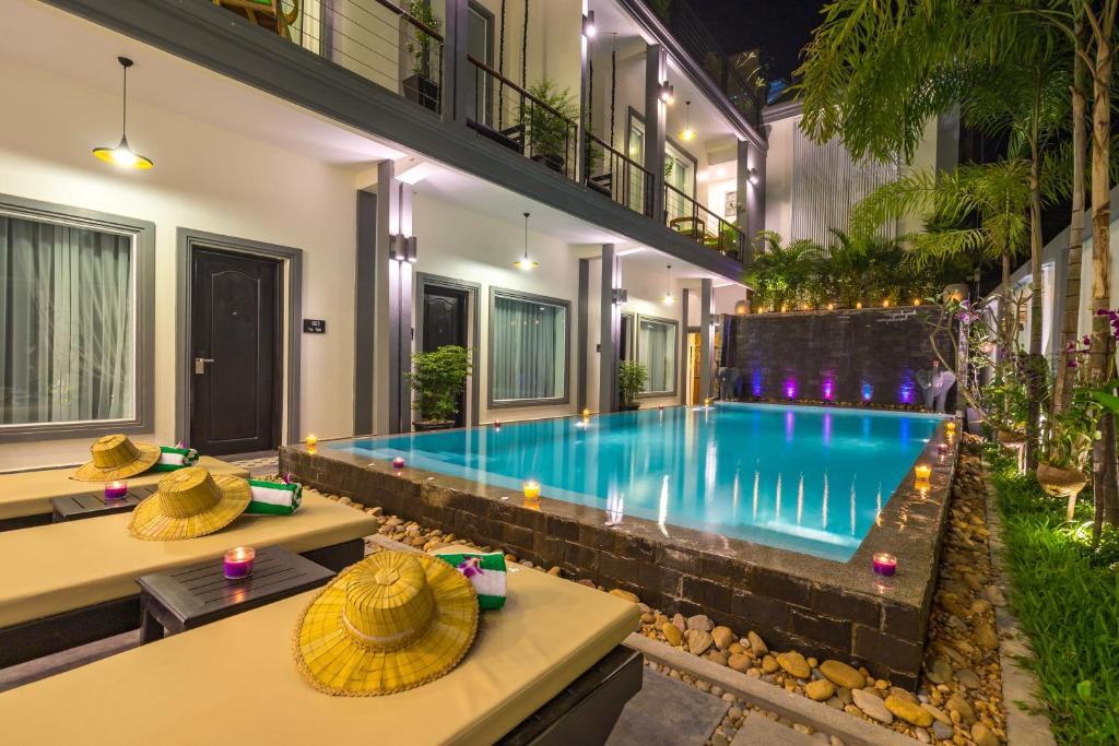 The swimming pool at or close to Vilada Angkor Boutique