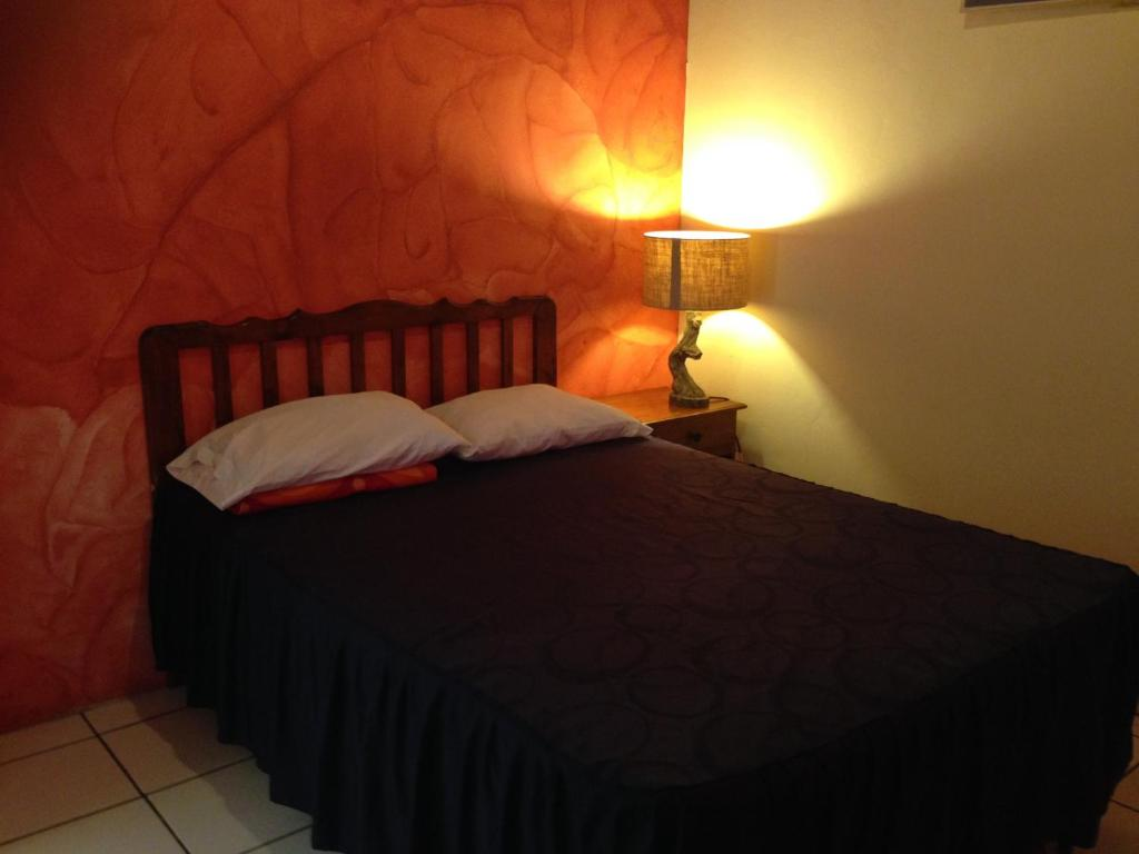 A bed or beds in a room at Hotel Panamericano