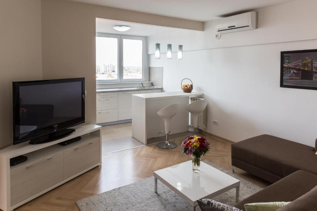TV i/ili multimedijalni sistem u objektu Apartment Admiral