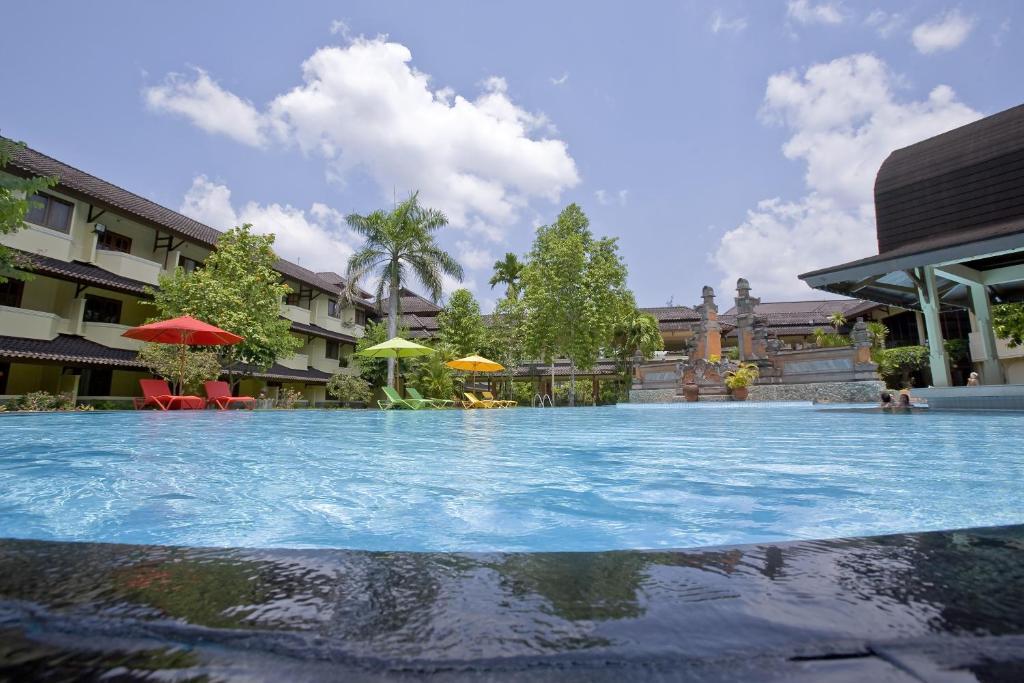 The swimming pool at or near Grand Legi Hotel Mataram