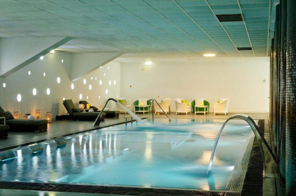 The swimming pool at or near Open Village Sports Hotel & Spa Club