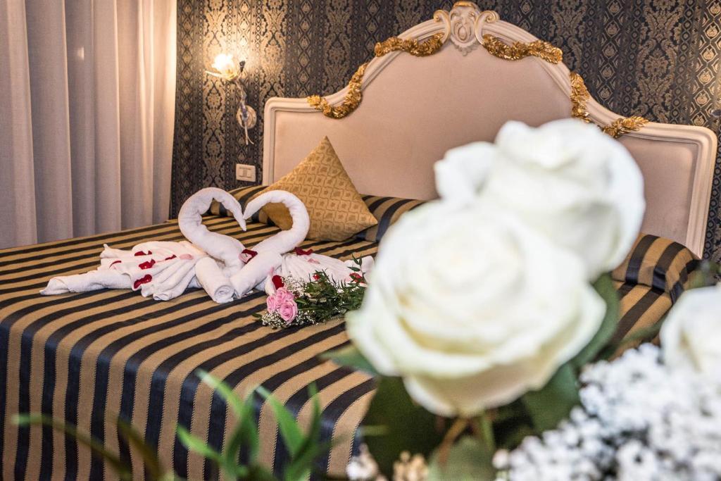 Postel nebo postele na pokoji v ubytování Residenza Nobile